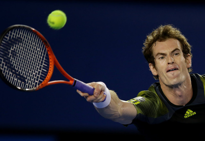 . Britain\'s Andy Murray hits forehand return to Serbia\'s Novak Djokovic during the men\'s final at the Australian Open tennis championship in Melbourne, Australia, Sunday, Jan. 27, 2013. (AP Photo/Aaron Favila)