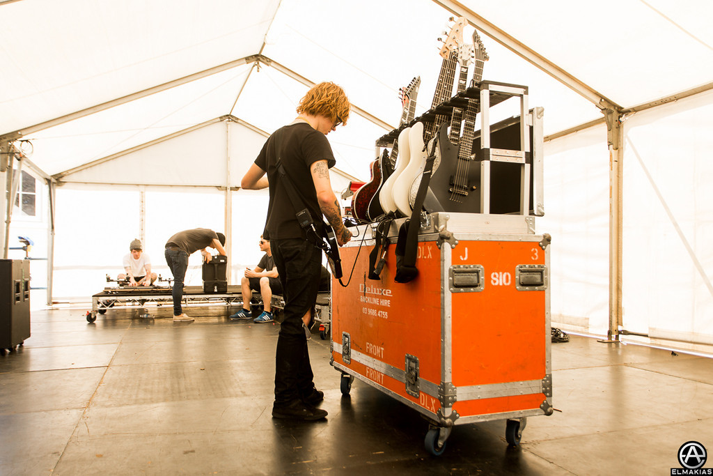 Alan getting his guitars ready