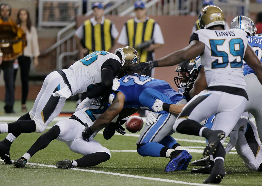 . Detroit Lions running back Mikel Leshoure (25) fumbles against the Jacksonville Jaguars in the second half of a preseason NFL football game at Ford Field in Detroit, Friday, Aug. 22, 2014.  (AP Photo/Duane Burleson)
