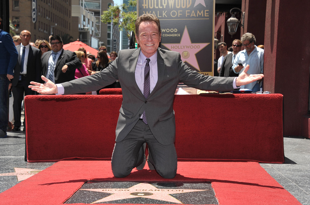 . Bryan Cranston poses on his new star on the Hollywood Walk of Fame on Tuesday, July 16, 2013 in Los Angeles. (Photo by John Shearer/Invision for AMC/AP Images)