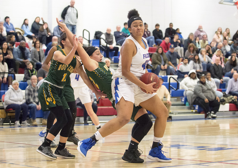 01/20/20  Wesley Bunnell | Staff  St. Paul Catholic girls basketball defeated Holy Cross 53-50 at home on Monday afternoon.  Jade Udoh (42).