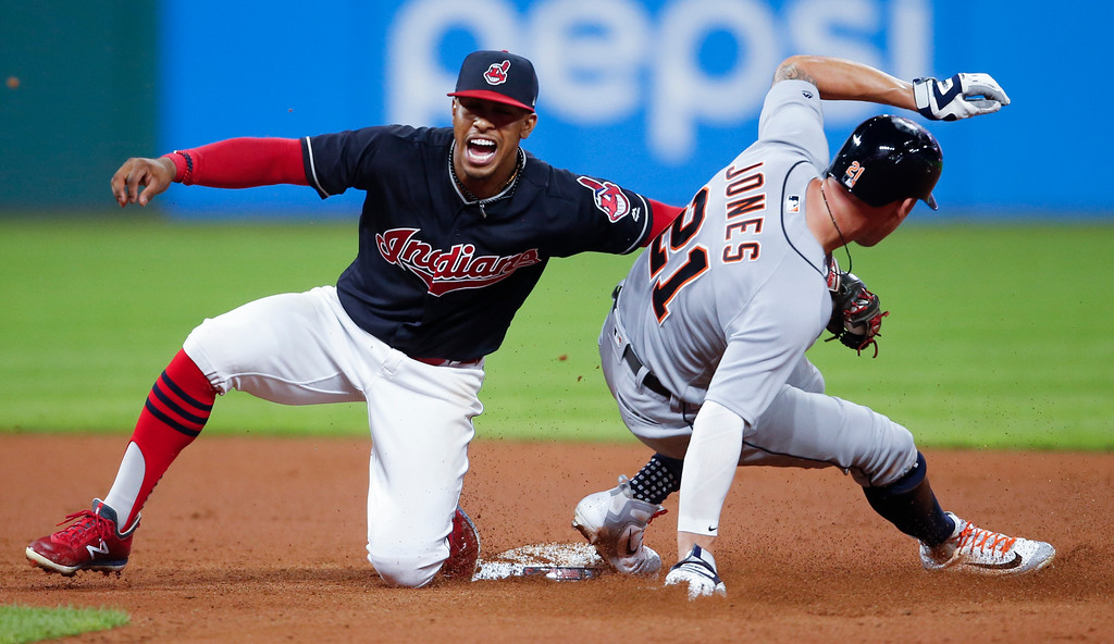 . Detroit Tigers\' JaCoby Jones, right, steals second base as Cleveland Indians\' Francisco Lindor attempts a tag during the eighth inning of a baseball game, Friday, Sept. 14, 2018, in Cleveland. (AP Photo/Ron Schwane)