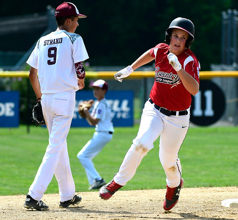 8/10/2018 Mike Orazzi | Staff Rhode Island's Logan Lama (15) drives in some runs during the Eastern Regional Little League Tournament at Breen Field in Bristol Friday.