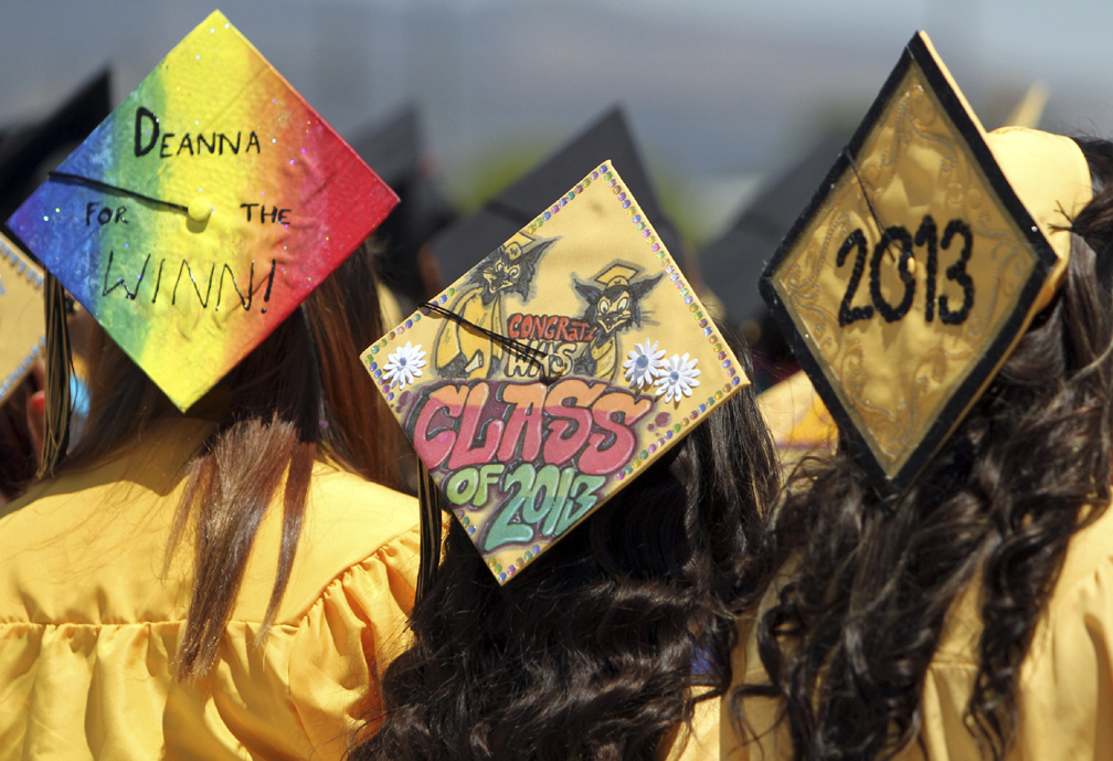. Colorful graduation caps flooded Watsonville High on Friday as the class of 2013 gathered at the school\'s football field for the graduation ceremony. (Kevin Johnson/Sentinel)