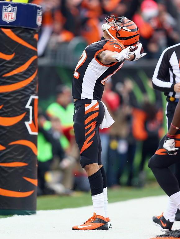 . Marvin Jones #82 of the Cincinnati Bengals celebrates after catching a pass for a touchdown during the NFL game against the Baltimore Ravens  at Paul Brown Stadium on December 29, 2013 in Cincinnati, Ohio.  (Photo by Andy Lyons/Getty Images)