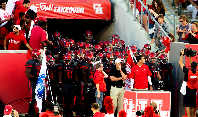 Tom Herman is about to lead our team in.