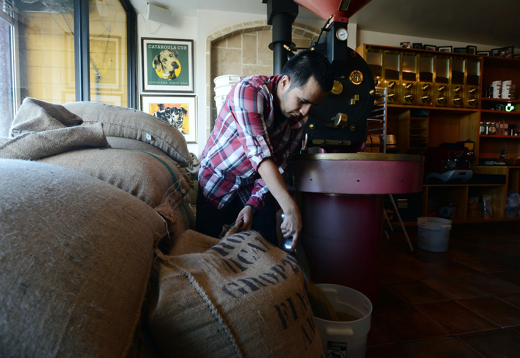 . Catahoula Coffee Company roaster Alfredo Zambrano mixes beans for a batch of Lola blend at the shop in Richmond, Calif. on Thursday, Jan. 17, 2013. (Kristopher Skinner/Staff)