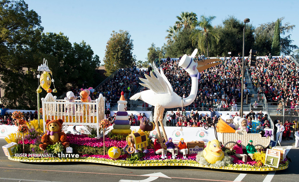 ". Kaiser Permanente ""First Steps to Total Health\"" float during 2014 Rose Parade in Pasadena, Calif. on January 1, 2014. This float won Lathrop K. Leishman award for most beautiful non-commercial float. (Staff photo by Leo Jarzomb/ Pasadena Star-News)"