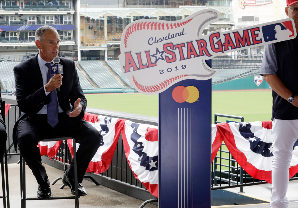. Tony Petitti, MLB Deputy Commissioner, Business & Media, talks during a news conference, Tuesday, Aug. 7, 2018, in Cleveland. Indians took the rock \'n\' roll route with a logo for the 2019 All-Star Game that won\'t offend anyone. The Indians are hosting the event for the sixth time, and next year\'s game coincides with the 25th anniversary of Progressive Field. (AP Photo/Tony Dejak)