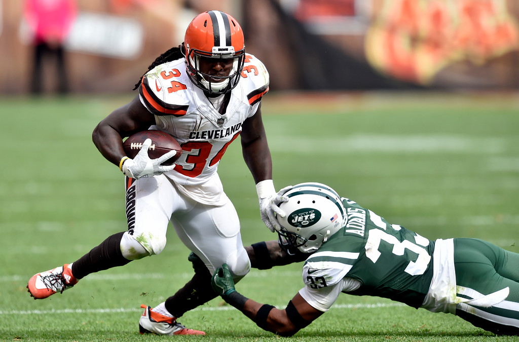 . Cleveland Browns running back Isaiah Crowell (34) rushes against New York Jets strong safety Jamal Adams (33) during the second half of an NFL football game, Sunday, Oct. 8, 2017, in Cleveland. (AP Photo/David Richard)
