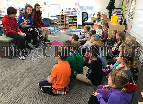 Pella Middle School reading to elementary