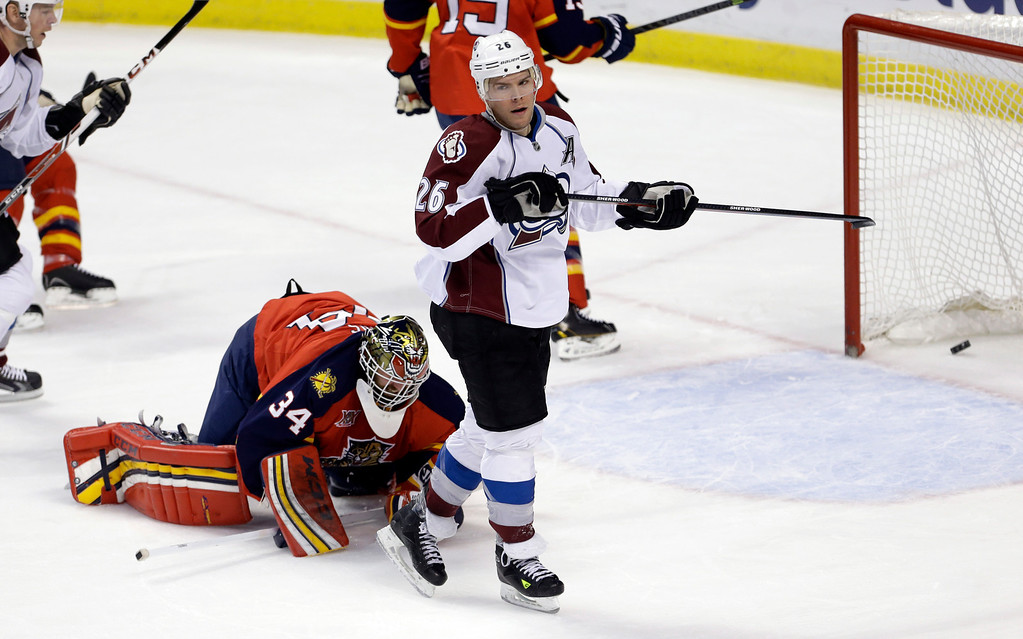 . Colorado Avalanche center Paul Stastny (26) scores a goal against Florida Panthers goalie Tim Thomas (34) during the first period of an NHL hockey game in Sunrise, Fla., Friday, Jan. 24, 2014. (AP Photo/Alan Diaz)