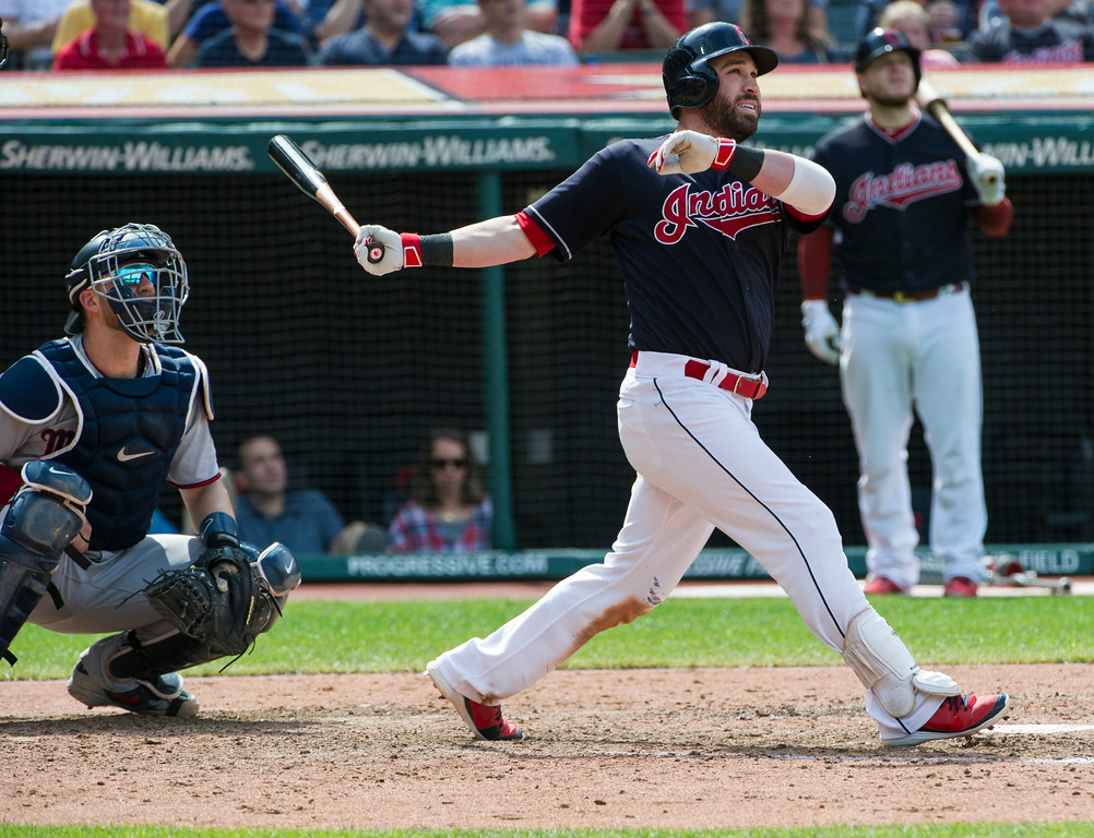 . Cleveland Indians\' Jason Kipnis watches his three-run home run off Minnesota Twins relief pitcher Alan Busenitz as Twins catcher Mitch Garver looks on during the sixth inning of a baseball game in Cleveland, Thursday, Aug. 30, 2018. (AP Photo/Phil Long)
