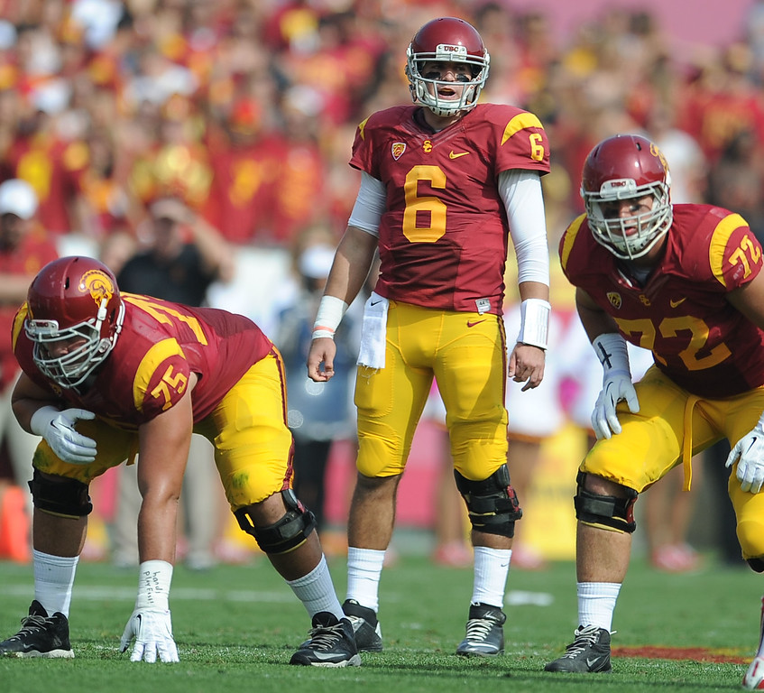 . Southern California quarterback Cody Kessler (6) looks over the Utah defense during the first half of an NCAA college football game in the Los Angeles Memorial Coliseum in Los Angeles, on Saturday, Oct. 26, 2013.  (Photo by Keith Birmingham/Pasadena Star-News)