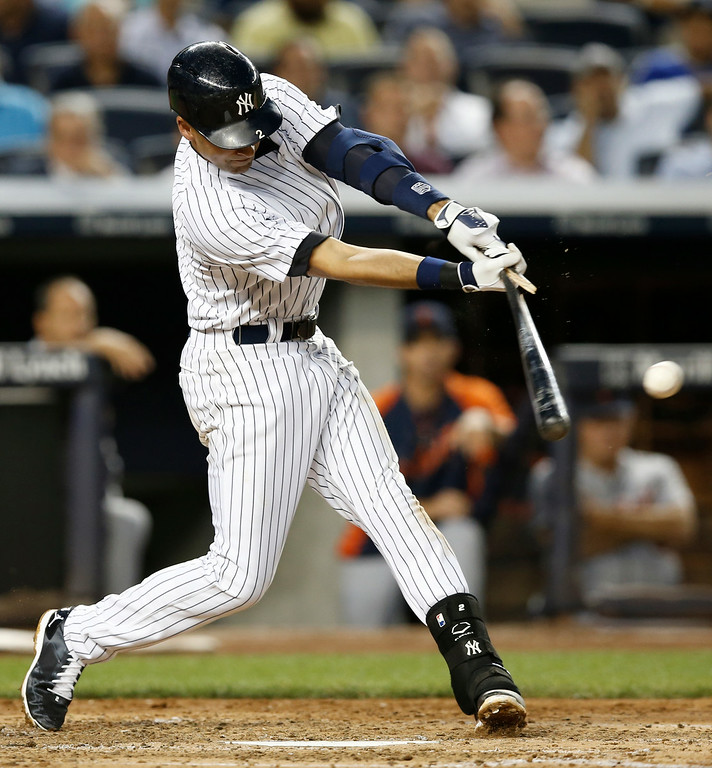 . New York Yankees Derek Jeter breaks his bat on a fourth-inning flyout in a baseball game at Yankee Stadium in New York, Wednesday, Aug. 6, 2014.  (AP Photo/Kathy Willens)