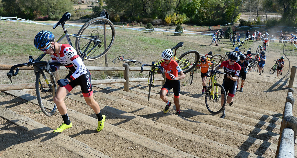 . BOULDER, CO - October 13, 2018: Oliver Howson, left, leads the   pack up the stairs during the first lap of the Alfalfa�s Eldora US Open cyclocross championship men\'s junior race at Valmont Bike Park in Boulder.  (Photo by Cliff Grassmick/Staff Photographer)
