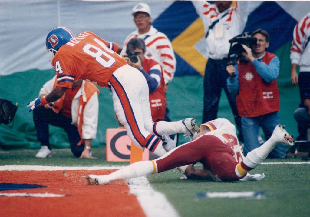 . 1988 - Ricky Nattiel scores on the first play of the Broncos first possession. Super Bowl. (Karl Gehring/The Denver Post)