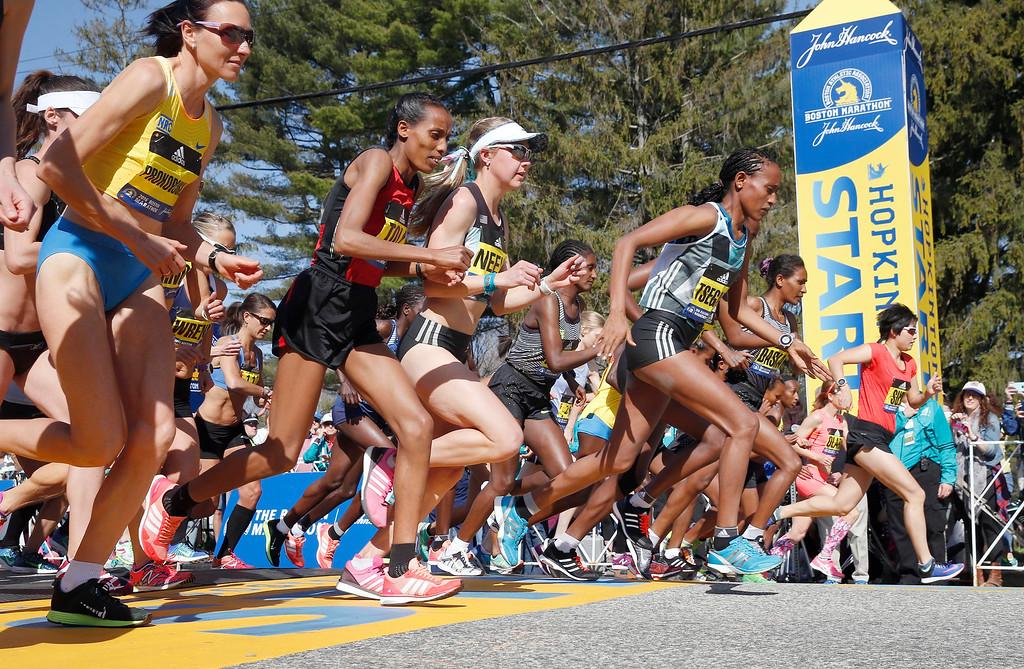 . The elite women cross the Boston Marathon start line in Hopkinton, Mass., Monday, April 18, 2016. (AP Photo/Michael Dwyer)