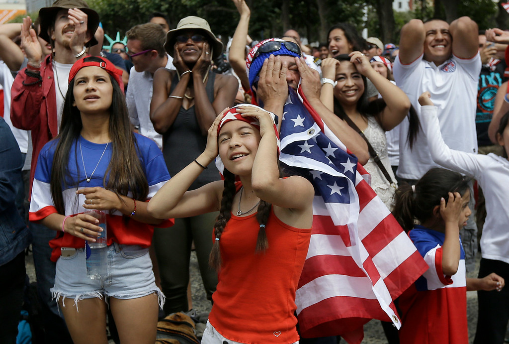 . Amy Mazariegos, foreground, reacts with other United States fans as they watch the World Cup round of 16 soccer match between the United States and Belgium at a public viewing party in San Francisco, Tuesday, July 1, 2014. Belgium won 2-1. (AP Photo/Jeff Chiu)