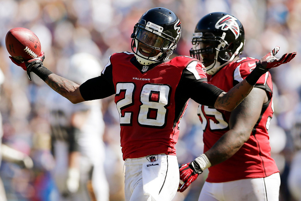 . ATLANTA FALCONS - Atlanta Falcons free safety Thomas DeCoud celebrates an interception against the San Diego Chargers during the second half of an NFL football game in San Diego on Sept. 23, 2013. (AP Photo/Gregory Bull, File)
