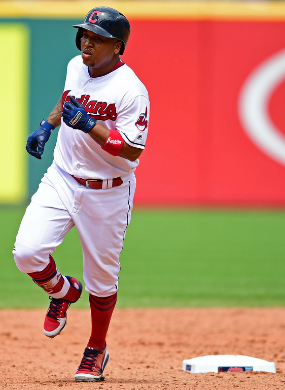 . Cleveland Indians\' Jose Ramirez runs the bases after hitting a solo home run off Detroit Tigers relief pitcher Artie Lewicki in the sixth inning of a baseball game, Sunday, June 24, 2018, in Cleveland. The Indians won 12-2. (AP Photo/David Dermer)