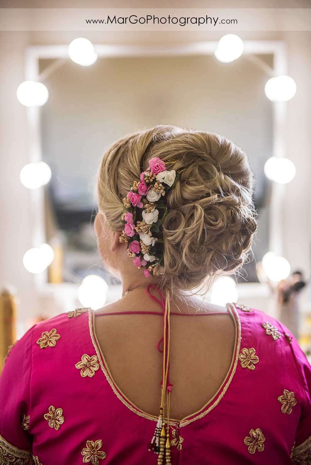 Indian bridal hairstyle with pink and white roses