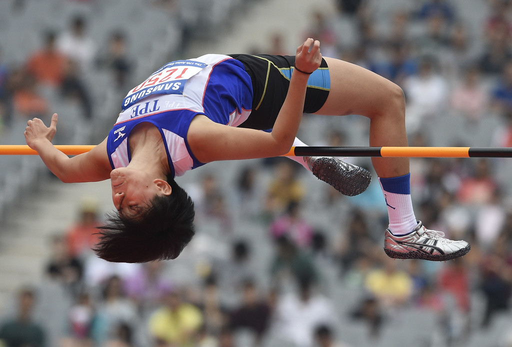 . Taiwan\'s Huang Yu Ting competes in the women\'s heptathlon high jump athletics event during the 17th Asian Games at the Incheon Asiad Main Stadium in Incheon on September 28, 2014.  MARTIN BUREAU/AFP/Getty Images