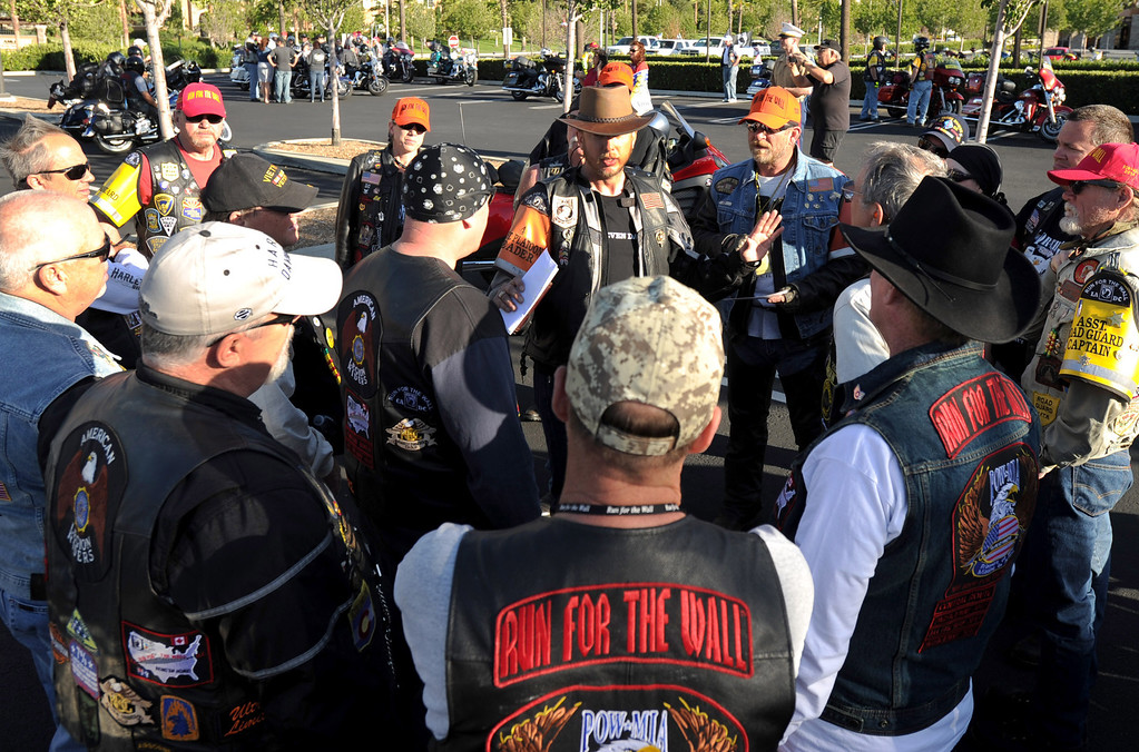 . Marine veteran Ryan Kendall (center) of Vista, Ca., talks with a group of Run For The Wall (RFTW) riders, before leaving  Victoria Gardens in Rancho Cucamonga, Ca., and heading to the Vietnam Memorial Wall in Washington D.C., May 14, 2014. (Photo by John Valenzuela/Inland Valley Daily Bulletin)