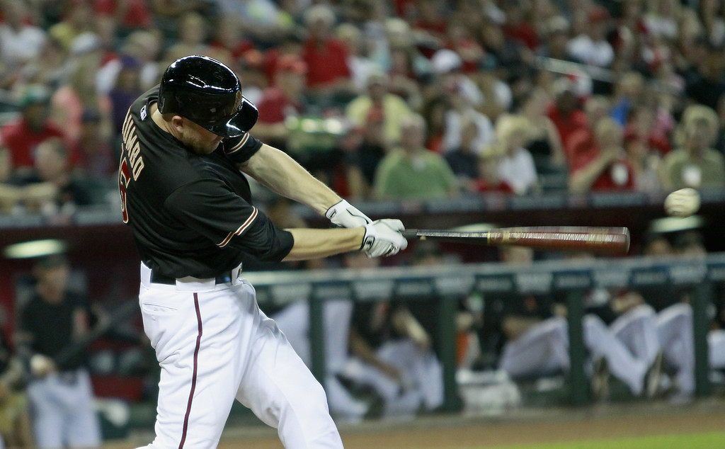 . Mark Trumbo #15 of the Arizona Diamondbacks hits a deep fly ball against the Colorado Rockies during the first inning of a MLB game at Chase Field on August 9, 2014 in Phoenix, Arizona.  (Photo by Ralph Freso/Getty Images)