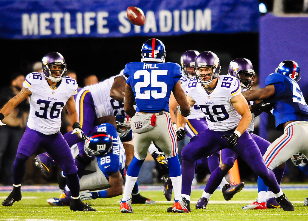 . Vikings defensive tackle Sharrif Floyd, background, loses the ball on a kickoff return in the fourth quarter against the Giants. (Pioneer Press: Ben Garvin)
