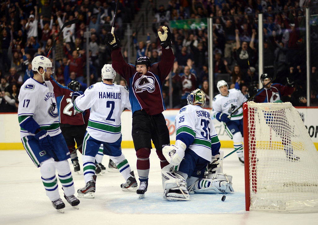 . DENVER, CO. - APRIL 13 : Cody McLeod of Colorado Avalanche (55) celebrates his teammate Jan HeJda\'s winning goal from goalie Cory Schneider of Vancouver Canucks (35) at Pepsi Center. Denver, Colorado. April 13, 2013. Colorado won 4-3. (Photo By Hyoung Chang/The Denver Post)