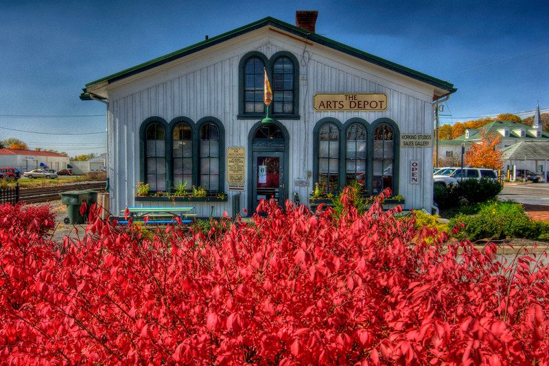 Red shrubbery blooms in front of The Arts Depot in Abingdon, VA on Friday, October 19, 2012. Copyright 2012 Jason Barnette
