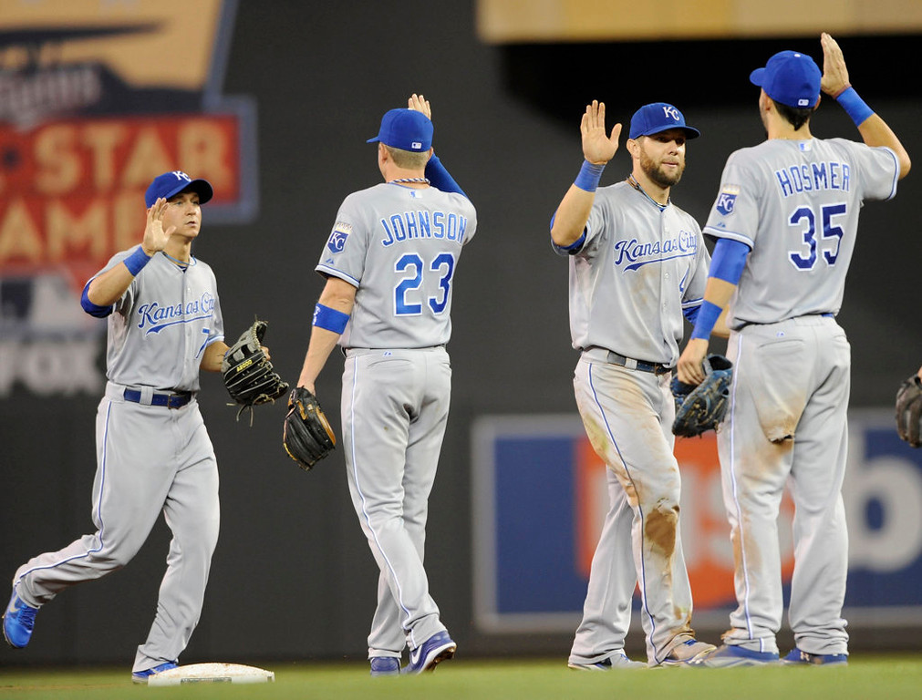 . Left to right, David Lough #7, Elliot Johnson #23, Alex Gordon #4 and Eric Hosmer #35 of the Kansas City Royals celebrate their 7-2 win over the Twins. (Photo by Hannah Foslien/Getty Images)