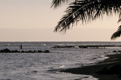 Lone Fisherman with Lanai in Background