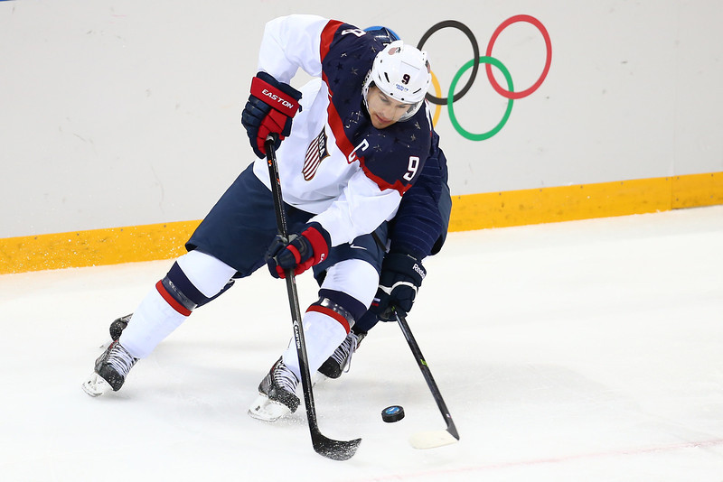 . Zach Parise #9 of United States controls the puck against Slovakia during the Men\'s Ice Hockey Preliminary Round Group A game on day six of the Sochi 2014 Winter Olympics at Shayba Arena on February 13, 2014 in Sochi, Russia.  (Photo by Streeter Lecka/Getty Images)