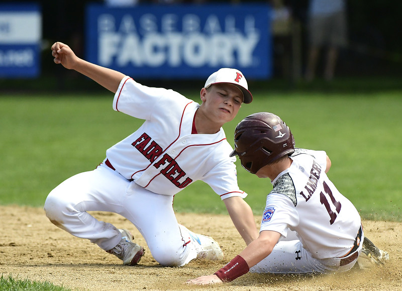 8/9/2018 Mike Orazzi | Staff Fairfield American Little League's Charlie Yates and Goffstown Junior Baseball Little League's Braeden Lambert (11) Thursday at Breen Field in Bristol.