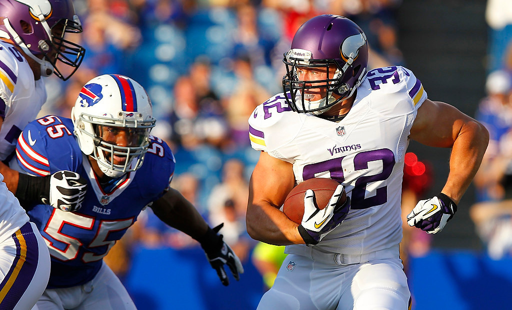 . Minnesota Vikings running back Toby Gerhart rushes during the first half of an NFL preseason football game as Buffalo Bills\' Jerry Hughes (55) chases the play Friday, Aug. 16, 2013, in Orchard Park, N.Y.  (AP Photo/Bill Wippert)