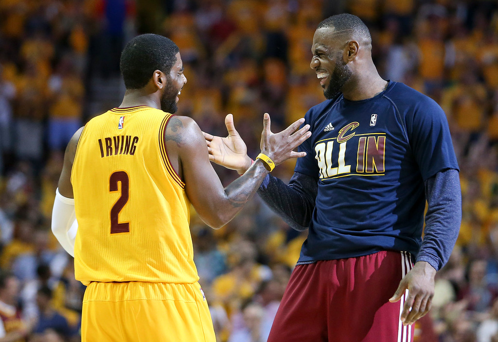 . Cleveland Cavaliers forward LeBron James (23) and Cleveland Cavaliers guard Kyrie Irving (2) slap hands during a timeout in the first quarter of Game 4 of the NBA basketball Eastern Conference Finals against the Atlanta Hawks, Tuesday, May 26, 2015, in Cleveland. (AP Photo/Ron Schwane)