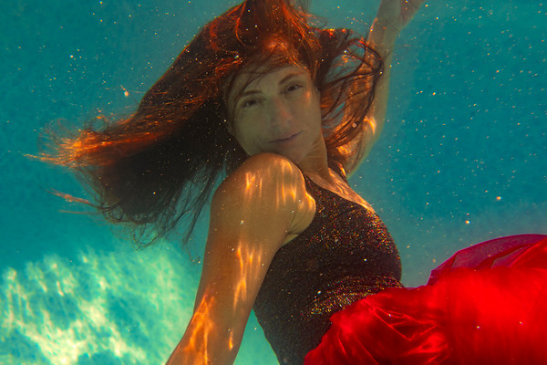 Nina in the pool with her flute