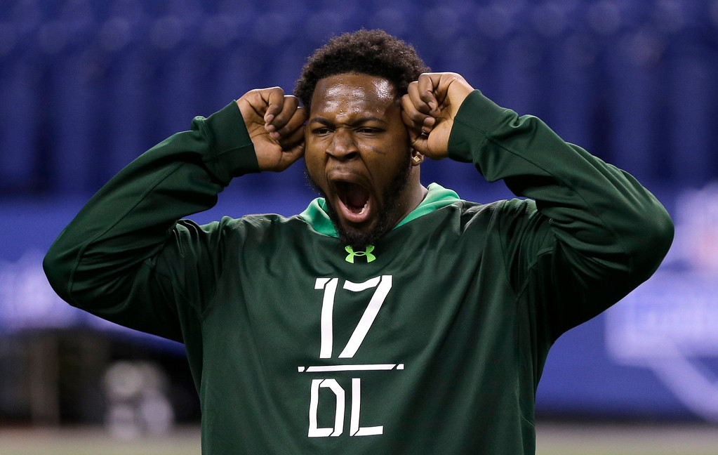 . Florida State defensive lineman Mario Edwards yawns while stretching before drills at the NFL football scouting combine in Indianapolis, Sunday, Feb. 22, 2015. (AP Photo/David J. Phillip)