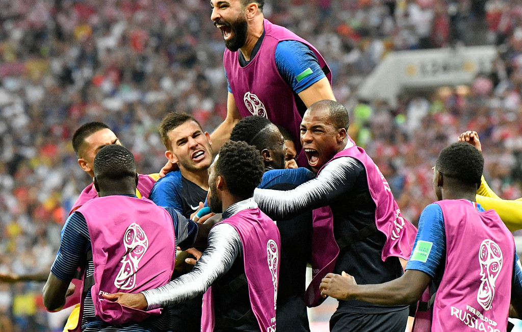 . French players celebrate after Kylian Mbappe scored his side\'s fourth goal during the final match between France and Croatia at the 2018 soccer World Cup in the Luzhniki Stadium in Moscow, Russia, Sunday, July 15, 2018. (AP Photo/Martin Meissner)