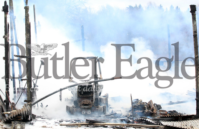 Harold Aughton/Butler Eagle: Barn fire at 455 West Sunbury Road, Monday, April 15.