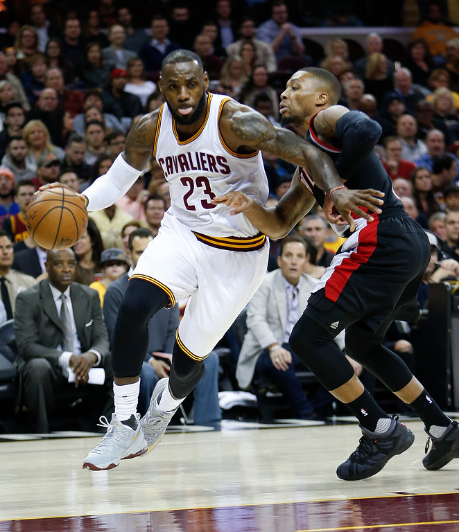 . Cleveland Cavaliers\' LeBron James (23) drives on Portland Trail Blazers\' Damian Lillard (0) during the first half of an NBA basketball game Wednesday, Nov. 23, 2016, in Cleveland. The Cavaliers won 137-125. (AP Photo/Ron Schwane)