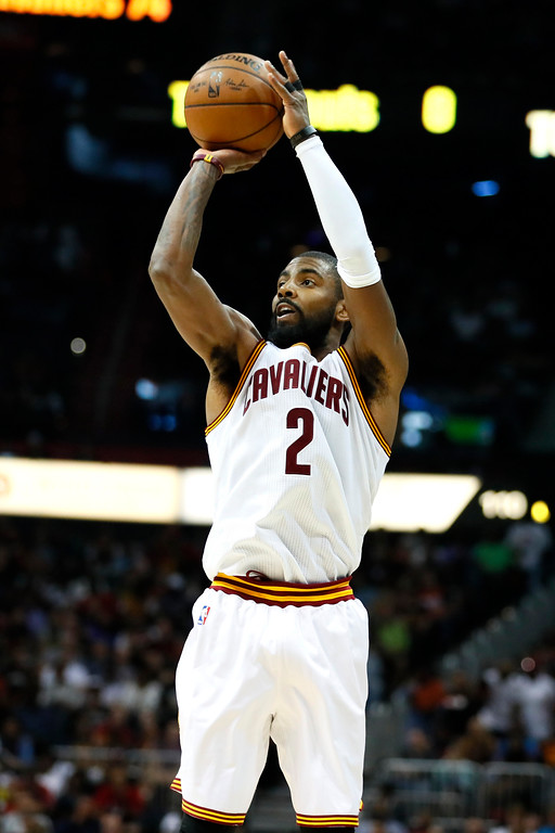 . Cleveland Cavaliers guard Kyrie Irving (2) shoots in the second half of an NBA basketball game against the Atlanta Hawks on Sunday, April 9, 2017, in Atlanta. The Hawks won in overtime 126-125. (AP Photo/Todd Kirkland)