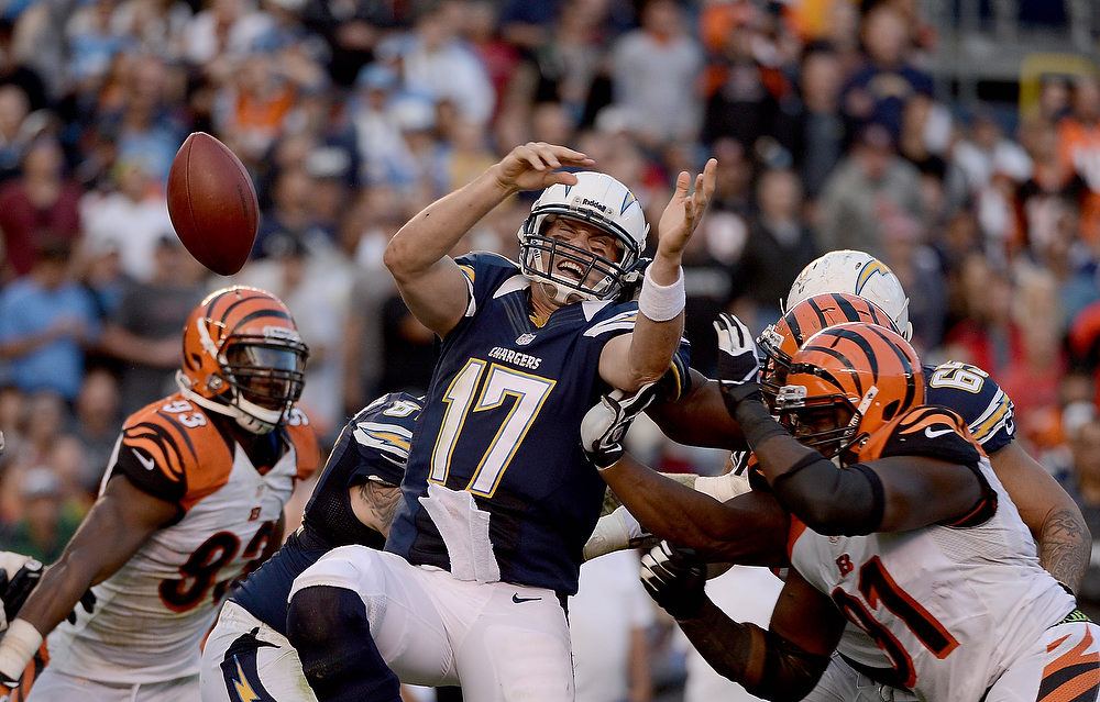 Description of . Philip Rivers #17 of the San Diego Chargers fumbles the ball against the Cincinnati Bengals on December 2, 2012 at Qualcomm Stadium in San Diego, California. (Photo by Donald Miralle/Getty Images)
