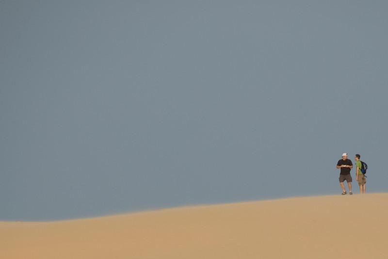 Tourists checking out the white sand dunes - Mui Ne, Vietnam