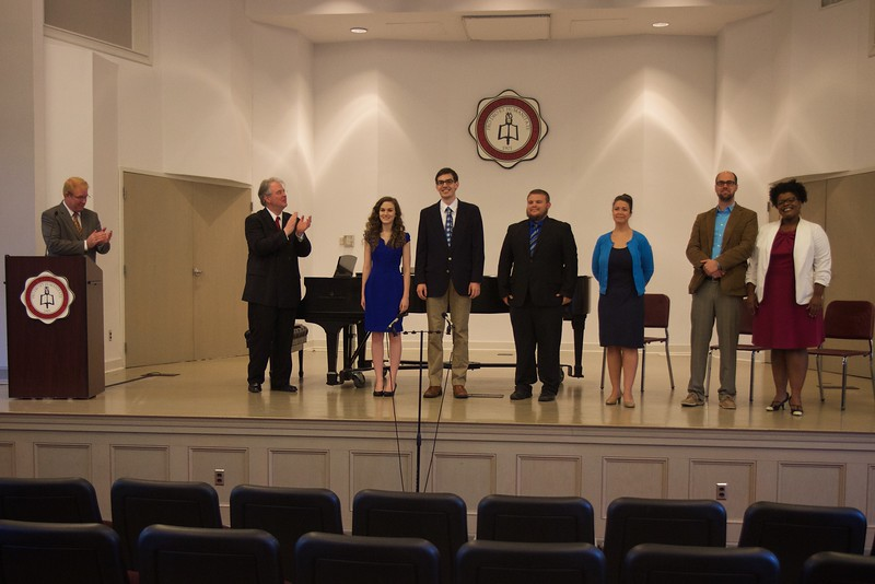 Passing of the Pi Kappa Lambda charter to initiate the Gardner-Webb Chapter of the national honors society for music, and induction ceremony.