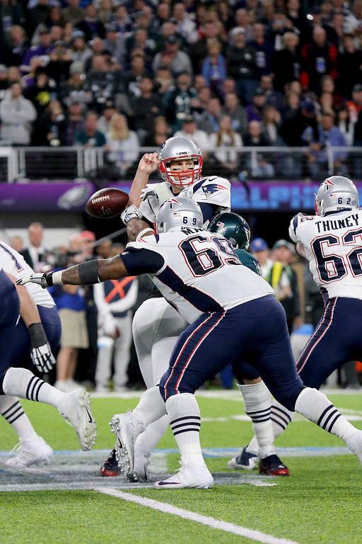 . New England Patriots quarterback Tom Brady fumbles after being stripped by Philadelphia Eagles Brandon Graham in the fourth quarter at Super Bowl 52 on Sunday, February 4, 2018 in Minneapolis. (AP Photo/Gregory Payan)