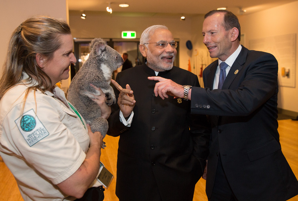 . BRISBANE, AUSTRALIA - NOVEMBER 15: India\'s Prime Minister Narendra Modi and Australia\'s Prime Minister Tony Abbott, meet Michele Barnes and Jimbelung the koala before the start of the first G20 meeting on November 15, 2014 in Brisbane, Australia. World leaders have gathered in Brisbane for the annual G20 Summit and are expected to discuss economic growth, free trade and climate change as well as pressing issues including the situation in Ukraine and the Ebola crisis.  (Photo by Andrew Taylor/G20 Australia via Getty Images)