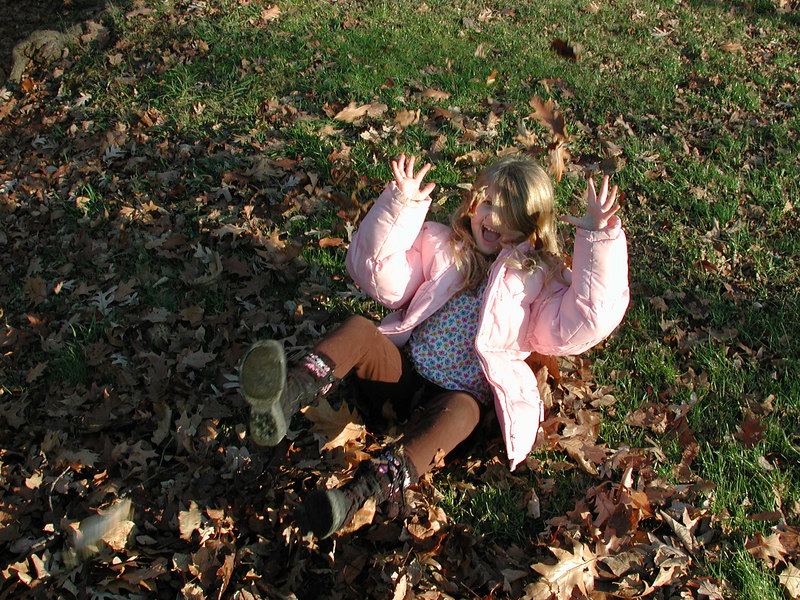 """""""Weee ... playing in the leaves."""""""